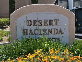 desert hacienda apartments sign
