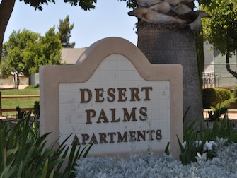 desert palms apartments sign