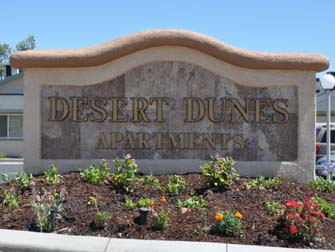 desert dunes apartments sign