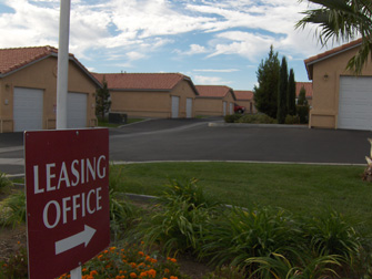 desert breeze apartments leasing office sign