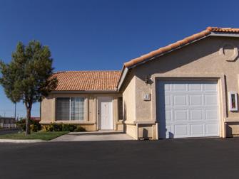 desert villas front yard with garage
